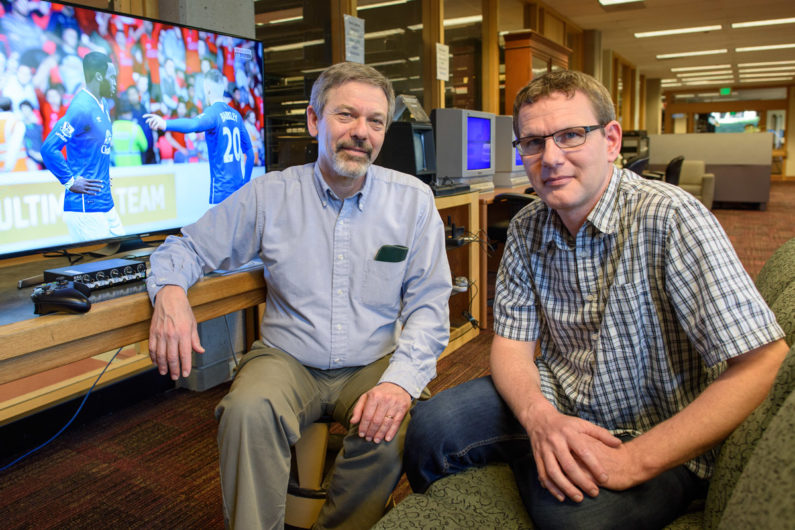 Henry Lowood curator, History of Science & Technology and Film & Media Collections and Ingmar Riedel-Kruse, assistant professor of bioengineering in the media library of Stanford's Green Library.